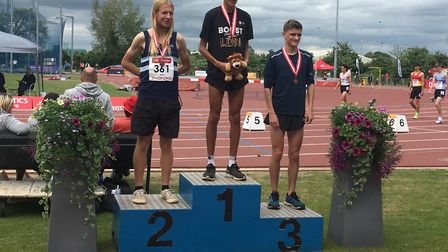 John Miller, left, on the podium after his second spot over 5,000m at the English National Under-23