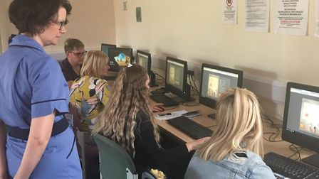 Claire Birch training hairdressers at West Suffolk College in skin cancer awareness Picture: SKCIN