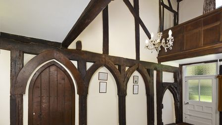 Oak arches which may feature the only English example of timber dog-toothed carving, at Grade 1 list