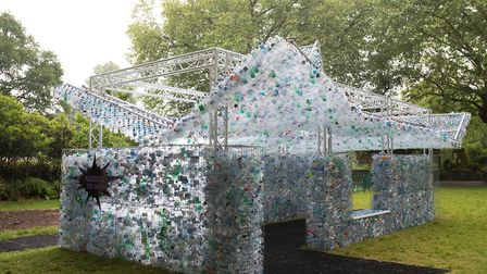 A 16ft high installation made from 15,000 discarded single-use bottles collected from locations incl