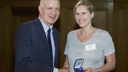 Dr Clare Gartland received her medallion Picture: CLIVE TOTMAN