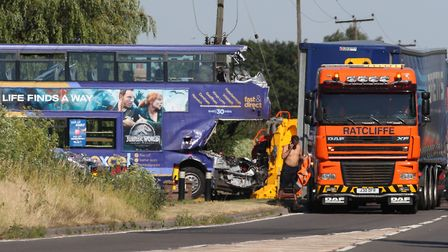 Two men travelling in a double-decker bus have died after it collided with a lorry on the A47 at Tho