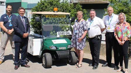 Hospital staff at West Suffolk Hospital pose with Help Appeal and My Golf Buggy colleagues and the n