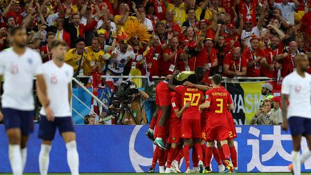Belgium players celebrate their side's winner against England Photo: PA