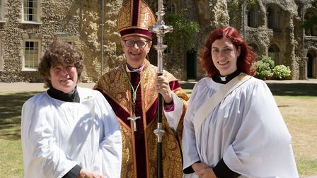 Bishop Martin Seeley with Cat Connolly, aged 28, right, and Jay Price, aged 67, who were the youngs
