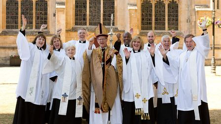 New priests for parishes across Suffolk celebrate their ordination with Bishop Martin outside St Edm