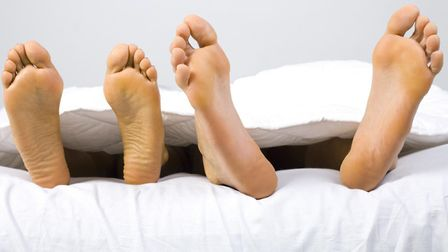 Cool feet can help you sleep when nights are hot... though one pair of feet may fare better. Picture