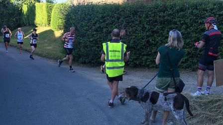 Marshalls, spectators and runners before the third-mile mark at High Green. Picture: CARL MARSTON