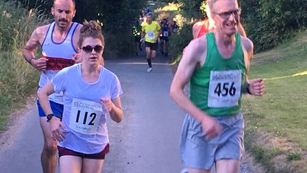 Daisy Glover (No. 112) was second lady at the Bury Friday Five. She is running alongside Peter West