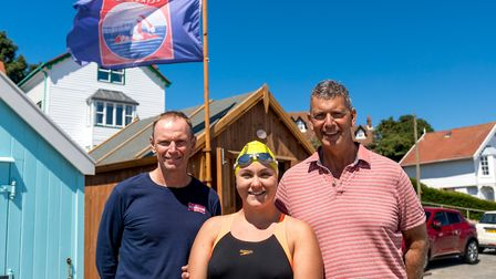 Channel swimmer Charlie Smith, pictured with her coach Seamus Bennett (left) and father John, at the