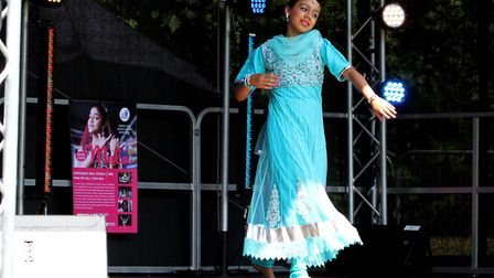 A young, local 11-year-old girl impresses the crowd by performing a Bollywood dance. Picture: JAMES