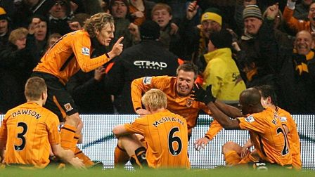 Hull City's Jimmy Bullard celebrates scoring the equaliser with his team-mates in his now well known