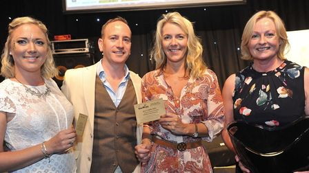 L to R: Becky and James Stott, from main event sponsors Abbeygate Wealth Management, presenting the