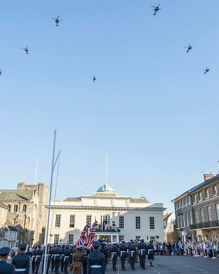 Crowds lined Angel Hill to see a flypast of Apache helicopters in Bury St Edmunds Picture ST EDMUNDS