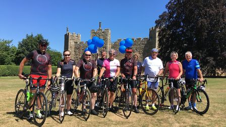 Cyclists on the fundraiser for Young Dementia UK stop off at Framlingham Castle during their final l