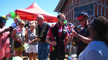 Peter Berry and fellow cyclists enjoy a warm welcome in Aldeburgh Picture: PETER BERRY