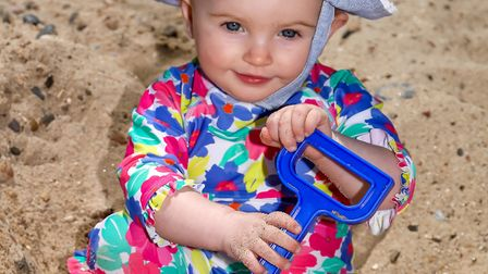 Forecasters are expecting another hot week - one-year-old Mabel Clark digging with her spade on Feli