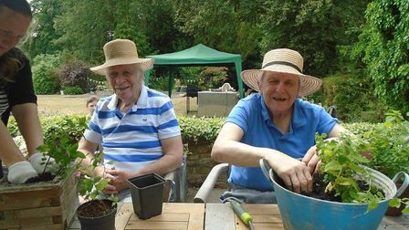 Residents helping with the garden spruce-up Picture: KINGSLEY HEALTHCARE