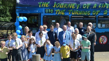 Staff, pupils and guests celebrate the unveiling of 'The Knight Bus' Picture: PHELAN CONSTRUCTION