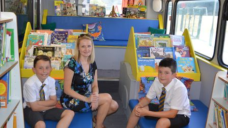 Headteacher Toni Kittle inside the new bus with pupils Picture: PHELAN CONSTRUCTION