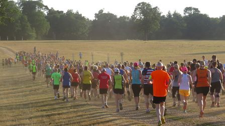 A field of 400-plus runners set out from Haughley Park on the Stowmarket Friday Five. Picture: JOHN