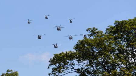 Chinook and Puma helicopters from the Royal Air Force fly over RAF Cranwell in Lincolnshire as a reh