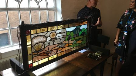 Jon Messum with his stain glass window which is set to go on display at Moyse's Hall Museum. Picture