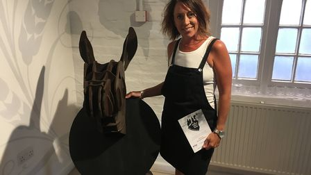 Michelle Freeman with her mule's head one of the pieces of artwork in the World War 1 Trail. Picture