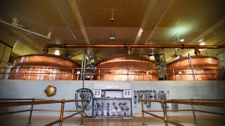 Large mash tuns inside the Greene King brewery. The brewing and distribution side is unaffected by t