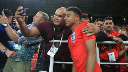 England's Jesse Lingard celebrates with fans after England beat Colombia on Tuesday night Photo: PA
