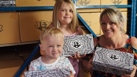 Emily Vigor with her children - Isabelle, 7 and Oscar, 3, with their Jex Shoes boxes. Picture: Emil
