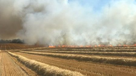 Firefighters tackled a field blaze in Moulton, near Newmarket Picture: SUFFOLK FIRE AND RESCUE
