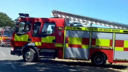Firefighters attending the fire in standing corn near Hengrave this week Picture: ANDY ABBOTT