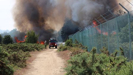 Bright orange flames and thick black smoke can be seen pouring over the range Picture: SIMON CLARKE