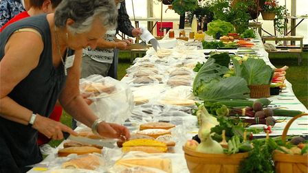 Judging the baking at a previous annual Village Show at Grundisburgh. Picture: ARCHANT