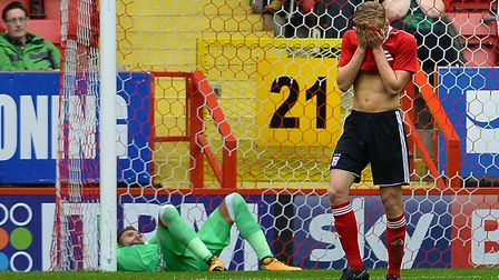 Flynn Downes holds his face in his hands during Town's 6-1 friendly defeat at Charlton last summer.