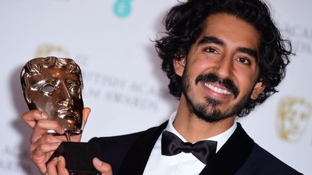 Dev Patel with his award for best Supporting Actor at the EE British Academy Film Awards. He is star