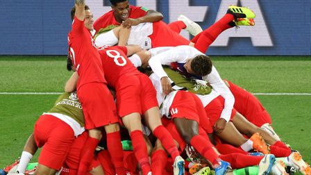 England players celebrate victory against Colombia in the penalty shoot-out last night. It is set to