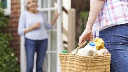 Calling in on elderly neighbours and assisting with shopping can help during hot weather. Picture: