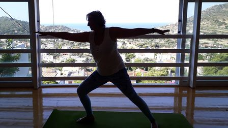 Sue Bayliss, practising her yoga pose in Greece. Picture: Sue Bayliss