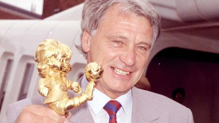 Former England manager Sir Bobby Robson, seen at Heathrow Airport with the Fair Play Award he receiv