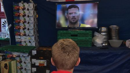 Watching the action during a break from trading at COxy's Fruit and Veg stall on Ipswich Market Pict