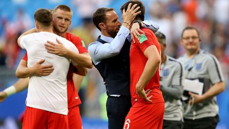 England manager Gareth Southgate (left) with England's Harry Maguire after the final whistle during