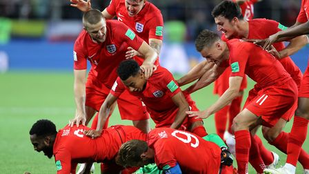 England players celebrate after their penalty shoot-out win against Colombia. Photo: PA