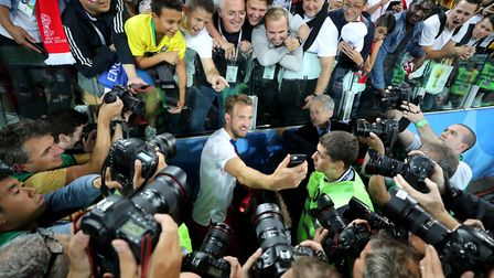 England's Harry Kane takes a selfie with fans after progress to the quarter-finals. Photo: PA