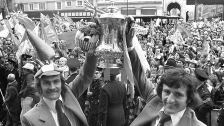 Mick Mills (left) and Roger Osbourne hold up the FA Cup in 1978. Photo: Archant