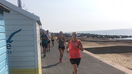 Runners approach the finish of the Felixstowe parkrun, along the promenade