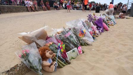 People gather on Gorleston beach to mark the one week anniversary of the tragic event leading to the