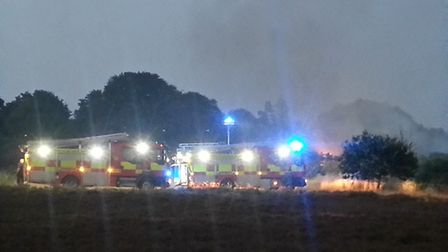 Fire crews attending the fire on Rushmere Heath on Friday Picture: DAVE BROWN