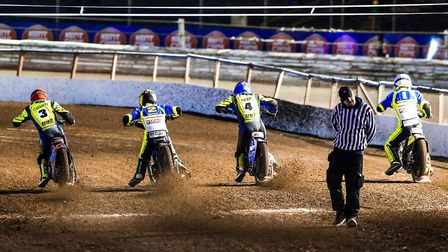 From the gate... At Foxhall Stadium, Ipswich, speedway at its best Photo: STEVE WALLER
